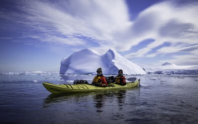 Father and son kayaking in Cierva Cove, Antarctica