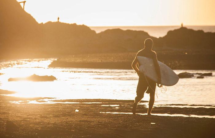 Costa Rica group tour surfer-beach---Chris-Goldberg