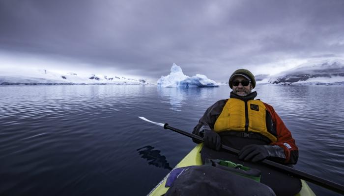 Kayaking among icebergs in Antarctica