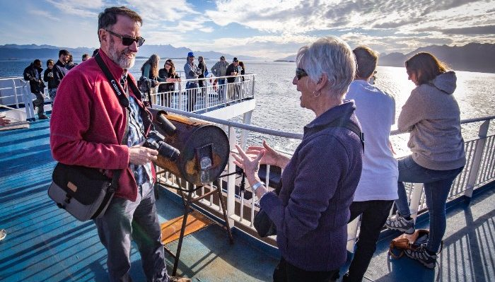 Passengers mingle on Antarctica-bound ship.