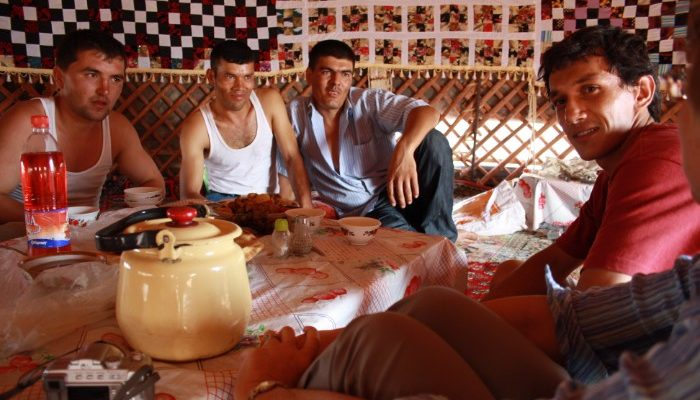 A group of locals sit around a table