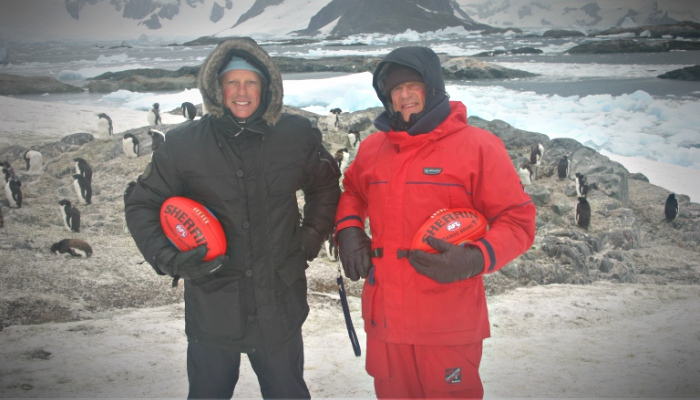 Posing with a football in Antarctica
