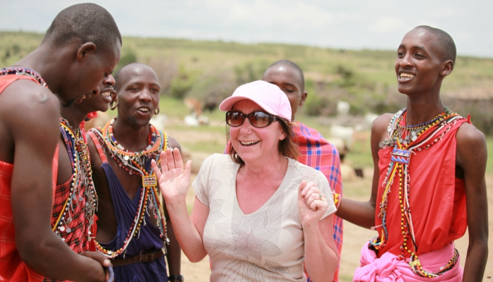 Traveller with Maasai people in Kenya