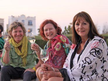 friends enjoying a rooftop drink