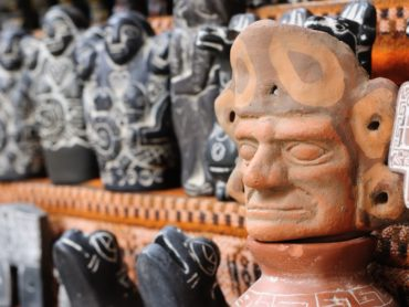 Terracotta totems on a shelf at the Witches Market