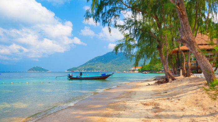 beach with long tail boat in Thailand
