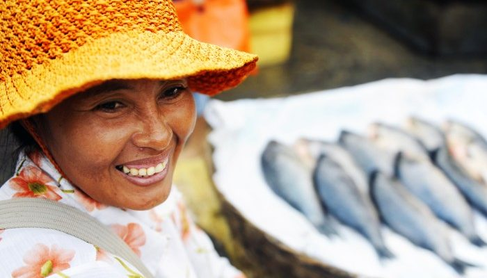 Cambodian woman with fish