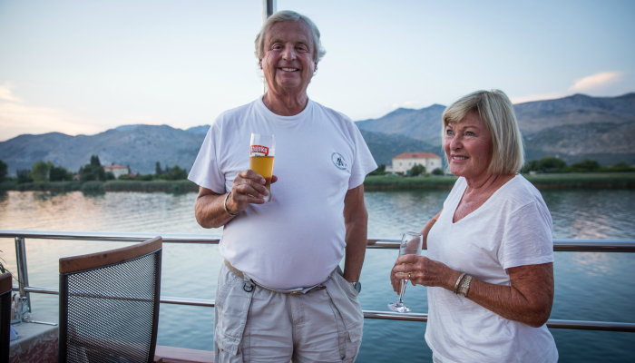 Couple drinking on deck of Croatia adventure cruise