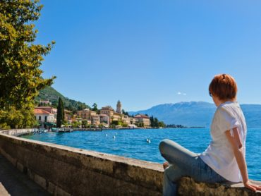 Woman sitting in front of Lake Como