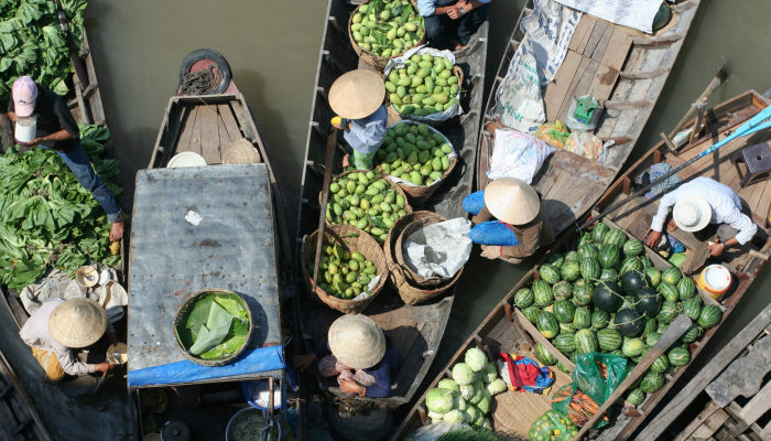 Fruit sellers at Cai Rang floating market in Vietnam