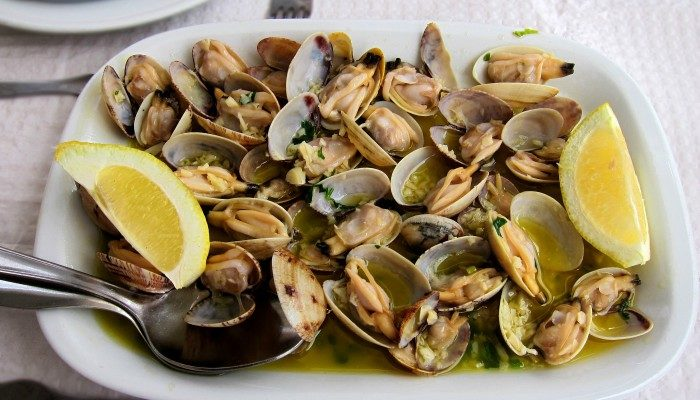Traditional Portuguese clams in white wine sauce