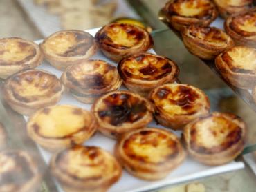 Pastel de nata in Portuguese bakery window