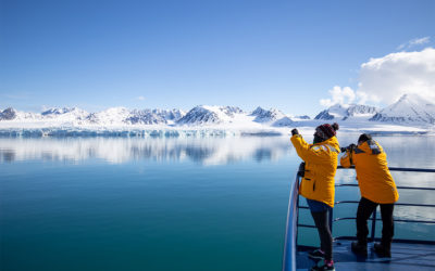 A traveller takes a photo at Lilliehookfjorden, Norway.