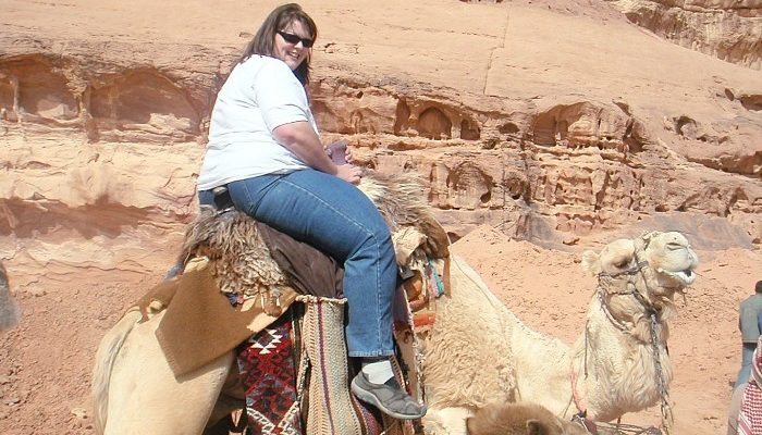Riding a camel in Wadi Rum.