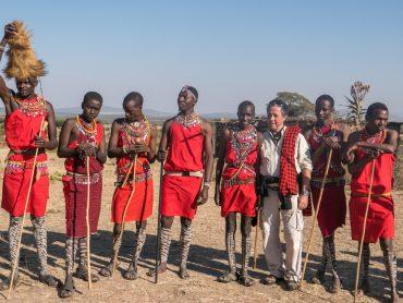 Maasai people and traveller