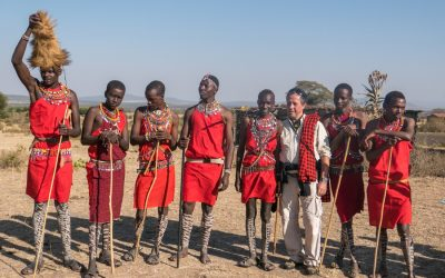 Maasai people and traveller