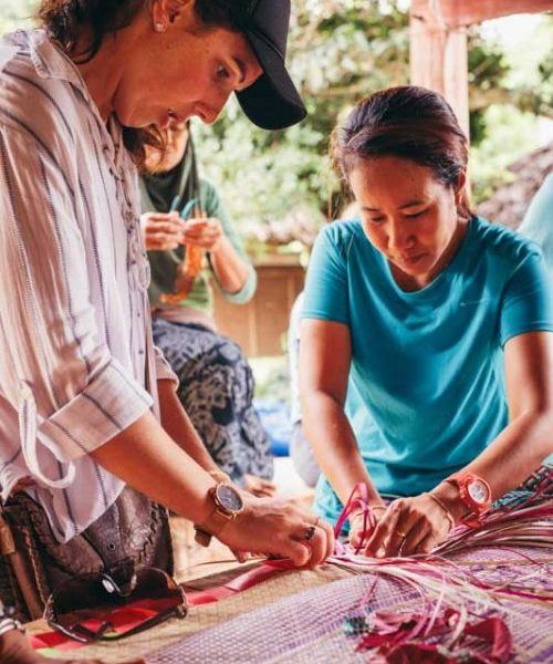 Two women weave in thailand