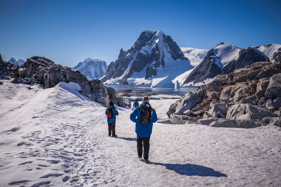 travellers walking on the Antarctic Peninsula