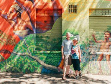 Older couple in front of street art, Santiago