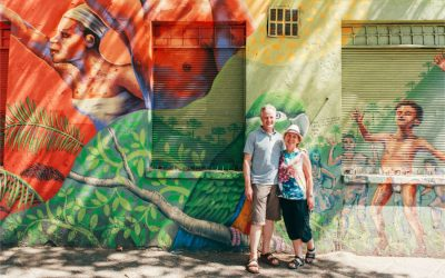 Older couple in front of street art, Santiago
