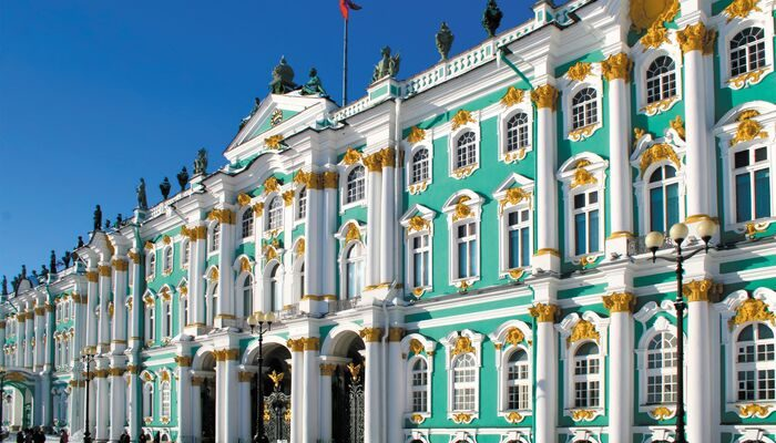 Winter Palace in Russia from the outside with blue skies in the background,