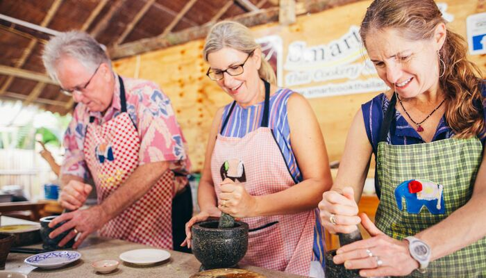 Three travellers at a cooking class in Thailand