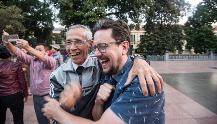 Two men hugging in Hanoi