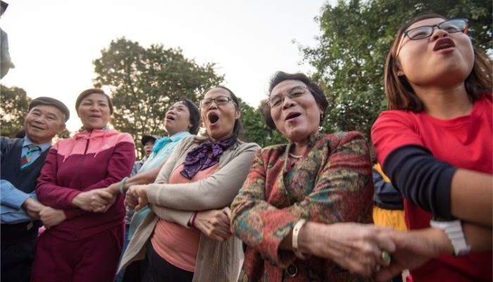 A group of women in Vietnam holding hands and laughing