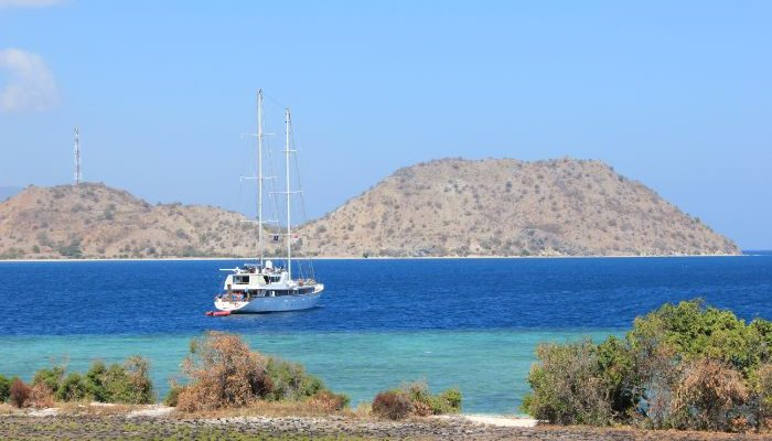 Small ship anchored in blue water