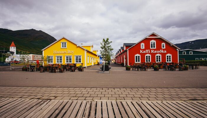 A yellow building and a red building in Iceland.