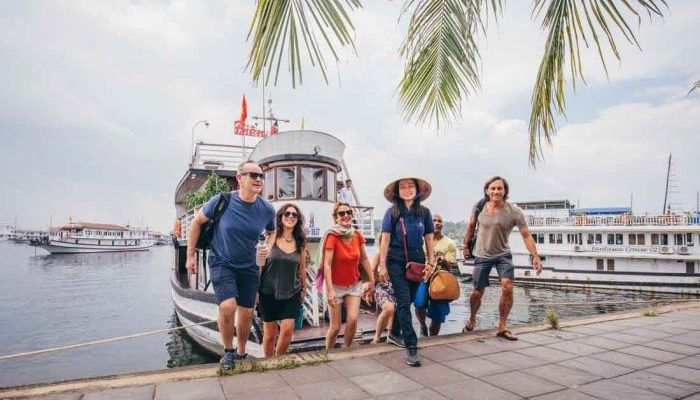 A group of travellers getting off a boat at a marina in Vietnam