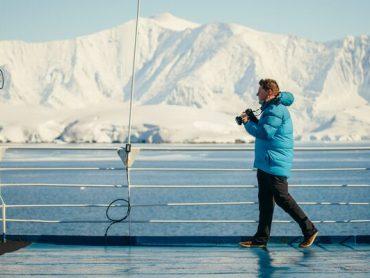 A traveller takes photos in Antarctica