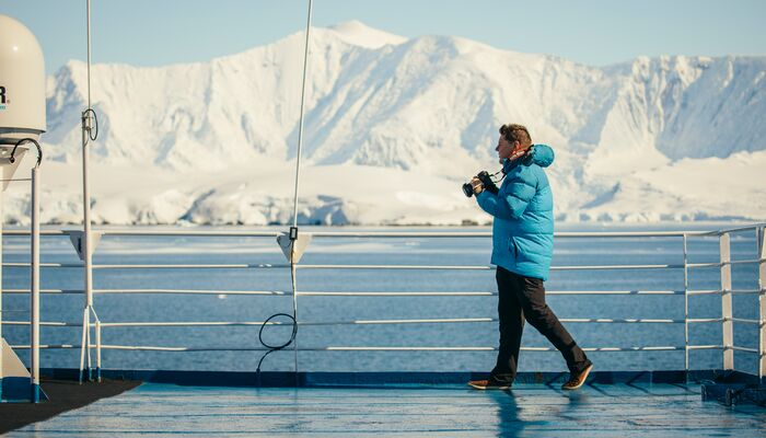 A traveller takes photos in Antarctica