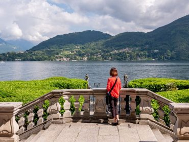 A woman looks over lake como