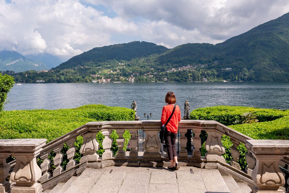 A woman looks over lake como