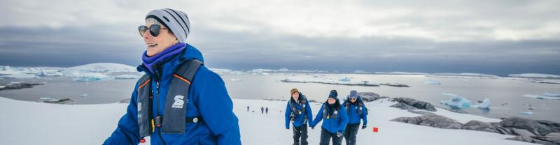 Passengers walk on Antarctic island
