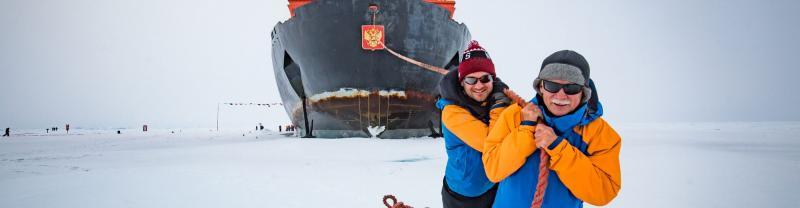 Travellers pretending to drag an icebreaker