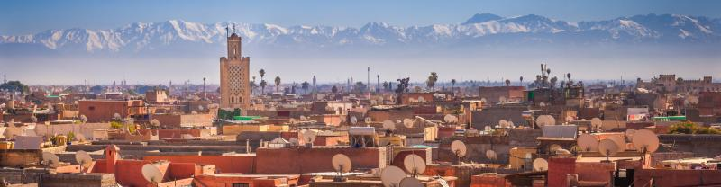 Morocco Marrakech rooftops of buildings and Atlas mountains