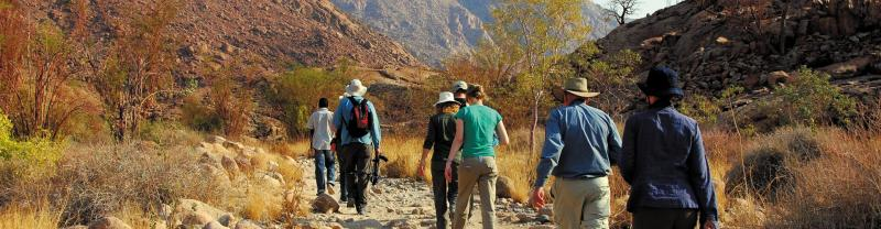 Peregrine Adventures  a group walking in desert in Namibia