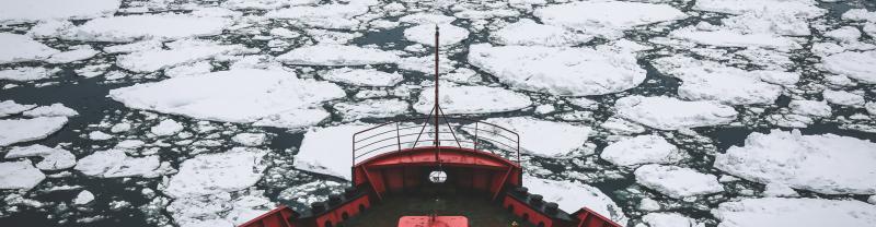 Boat breaking through ice in Canada Arctic