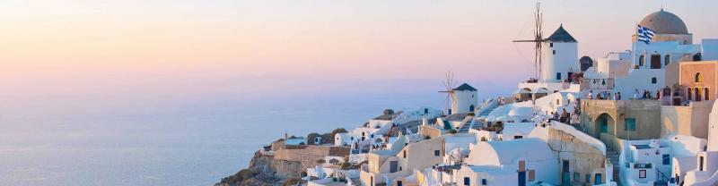 Sunsetting over the iconic white buildings in Santorini, Greece