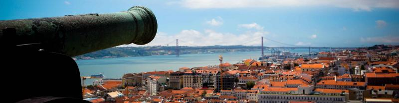 An old cannon looks out over the city of Porto, Portugal